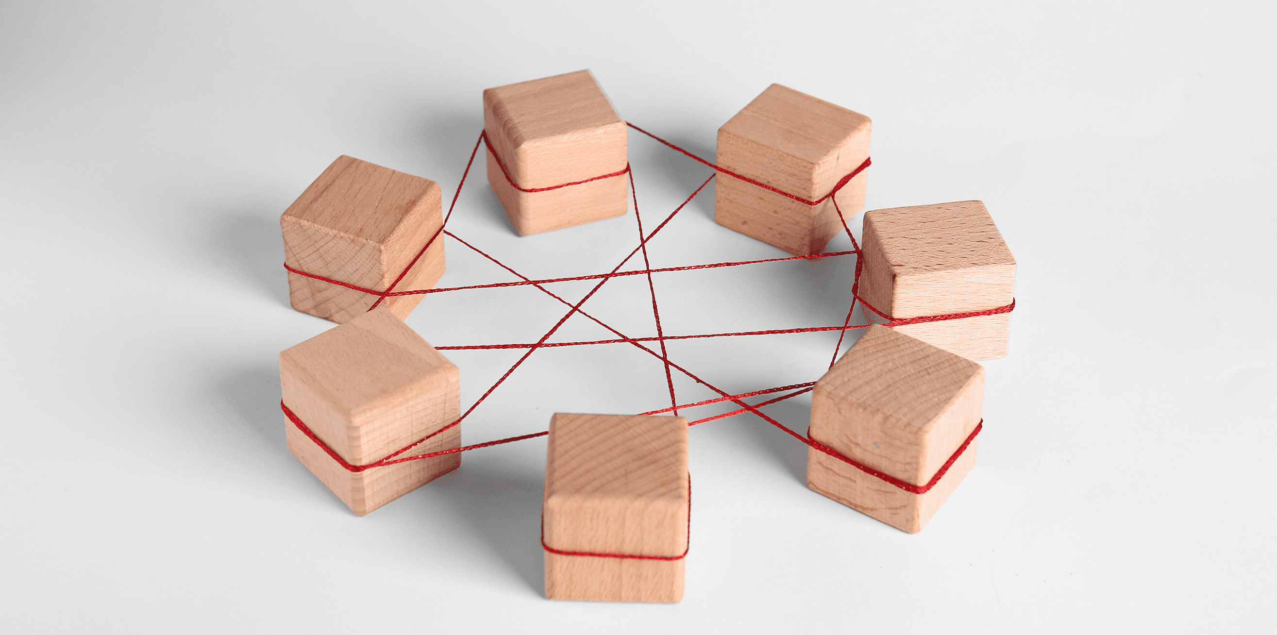 Wooden cubes tied with red thread